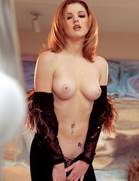 Elitta is a sexy young redhead with little puffy nips