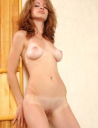 Exotic Venere exposes her tan lines while wearing long stockings. - Venere B - Xedia