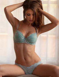Amber Sym takes off her teal bra
